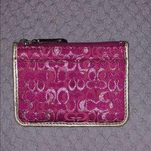 Coach pink change purse.